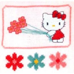 Kitty cueille des fleurs