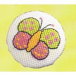 Badge blanc Papillon
